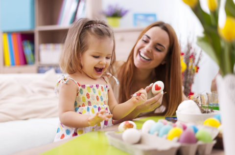 teacher and her student decorating the eggs