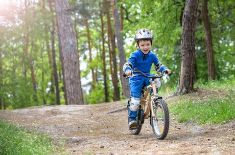 little boy doing a bike